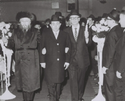 "הרב יוזפא מליסקא walking a young man to the chuppah. The chassan is Reb Tzvi Yosef (Hershel) Spiegel, z""l, whose wife, Mrs. Leah Spiegel, a""h, was a descendant of the Tal Chaim of Liska., הרב יוזפא מליסקא"