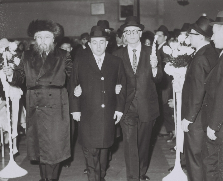"הרב יוזפא מליסקא walking a young man to the chuppah. The chassan is Reb Tzvi Yosef (Hershel) Spiegel, z""l, whose wife, Mrs. Leah Spiegel, a""h, was a descendant of the Tal Chaim of Liska., הרב יוזפא מליסקא,Tzvi Yosef (Hershel) Spiegel, , ezra friedlander"