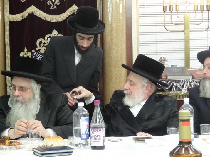 Liska Rebbe giving Kos shel brocha to his grandson Rav Alexander Sender Friedlander, , , ezra friedlander
